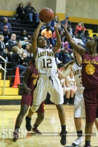 Deaundra Smith shoots in traffic in the second half. Smith's effort led the Rams with 7 points. Shine Rankin Jr./SGSN