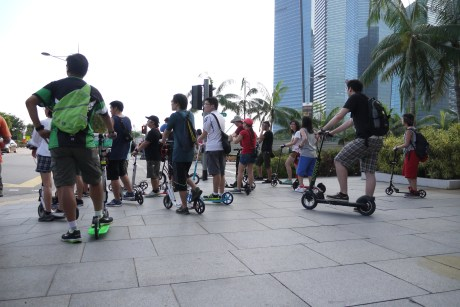 Community of electric and kick scooter riders at Marina Bay Sands Singapore