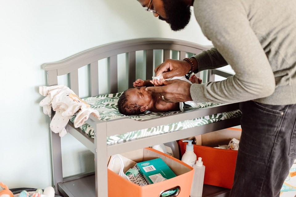 changing baby lifestyle newborn session philly