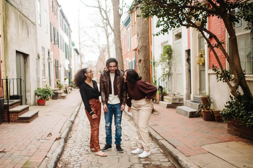 trio of siblings standing in Philadelphia