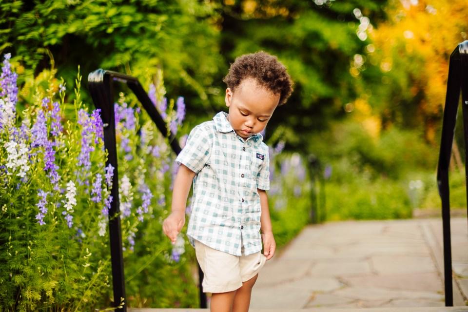 small boy plays in bartram's garden