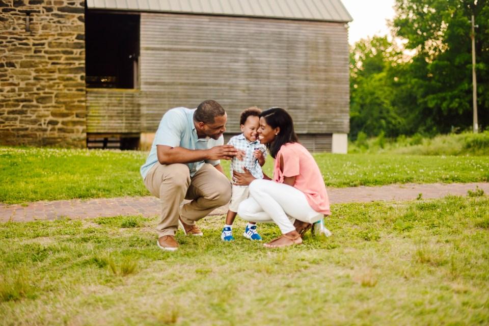 beautiful black family hugging in bartram's garden