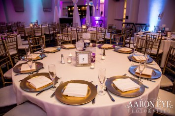 Charger plates and table settings at an Indian wedding reception in Newport Beach