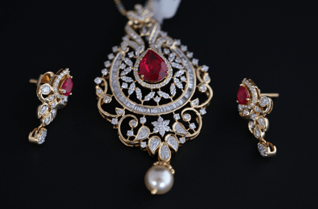pendant and earring set with ruby