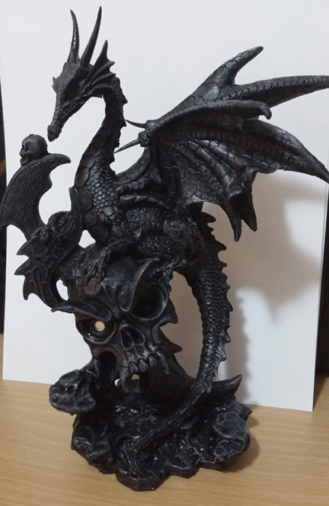 Dragon sitting on a skull statue