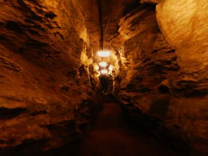 The corridor is a well lit tunnel about 5ft wide and 15 high of all native stone.