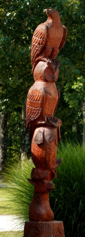 One of several tree-stump totem poles tucked between the sites