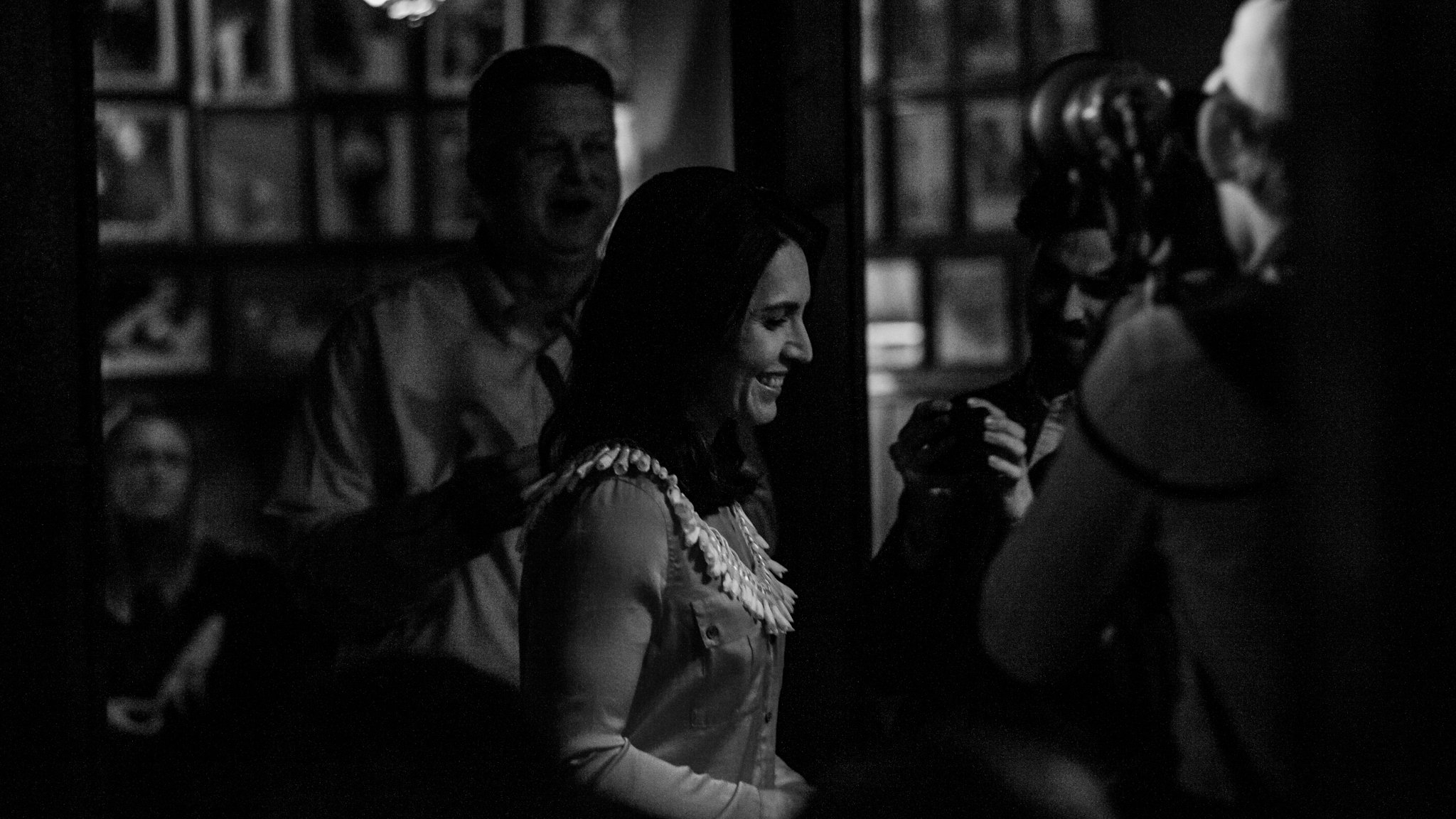Tulsi Gabbard walking to the stage at her campaign stop in Iowa City