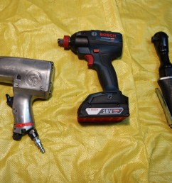 a cordless impact wrench like the one in the middle is a very useful tool i would highly recommend for anyone doing much work on cars  [ 5184 x 3456 Pixel ]