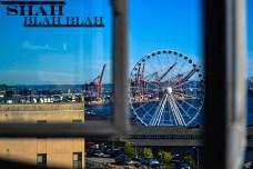 Seattle Great Wheel seen through a window from the Public Market.