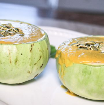 Opo squash soup served in opo squash bowls with seeds on top