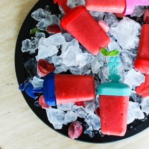 An overhead shot of watermelon strawberry popsicles
