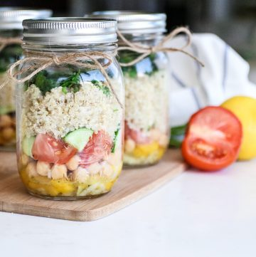 jars filled with layered quinoa chickpea salad