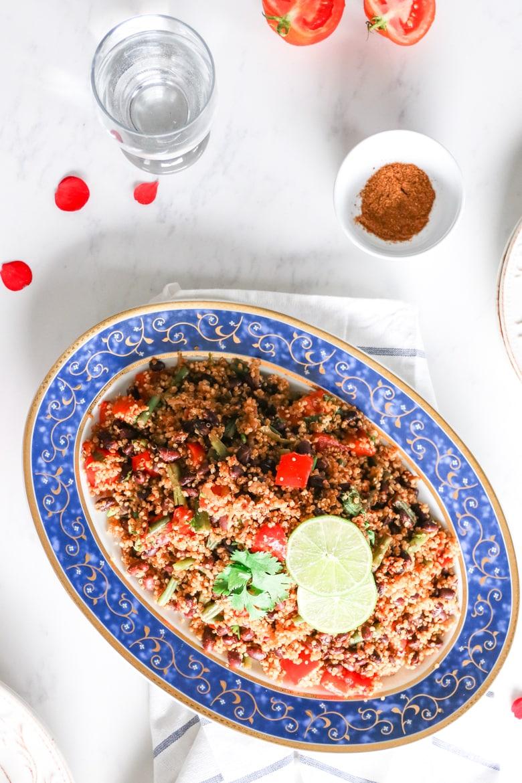 An overhead shot of quinoa vegetable pilau in a blue platter