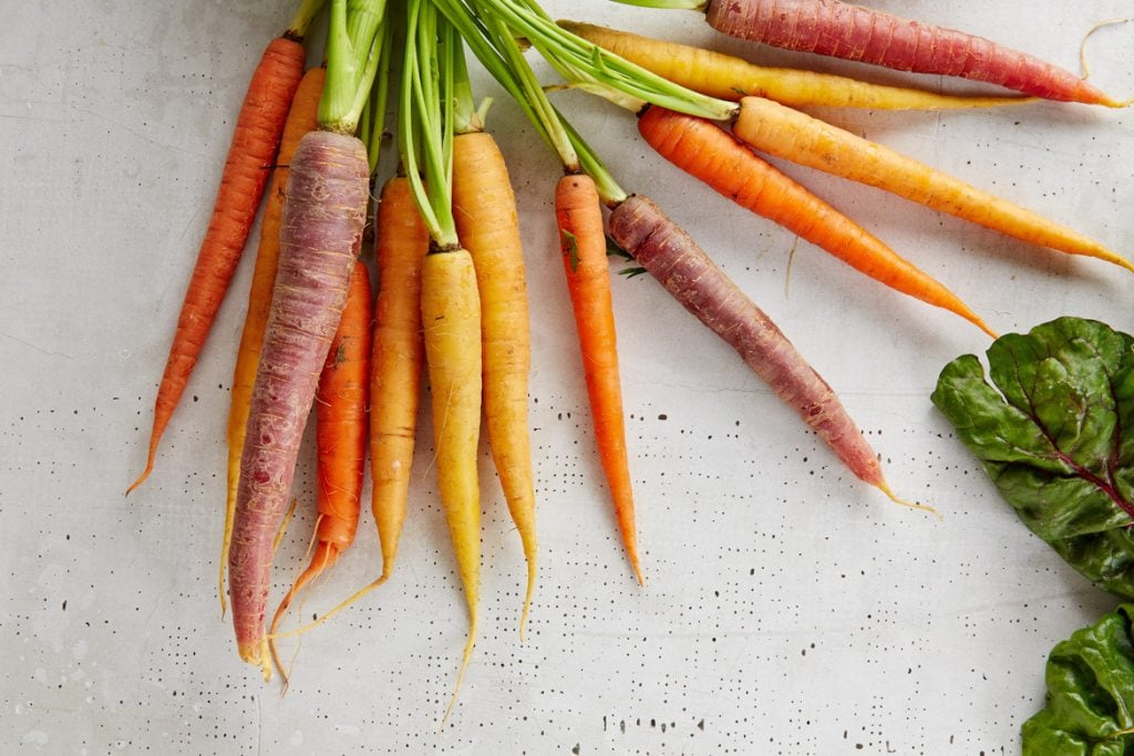 colourful carrots laying flat