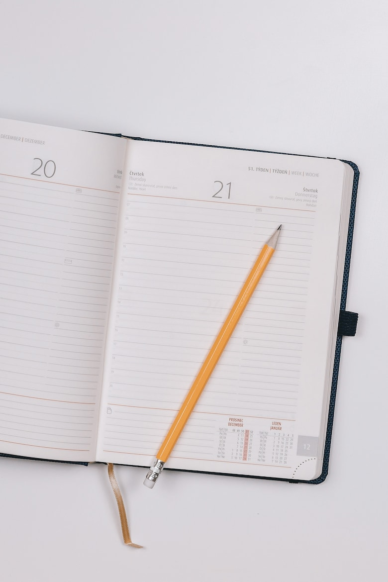 open diary with pencil on top