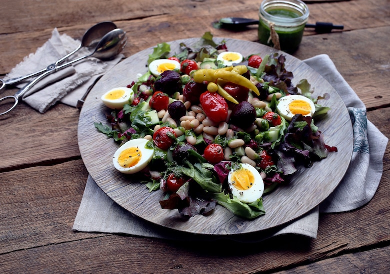 plate of bean and green salad with boiled eggs