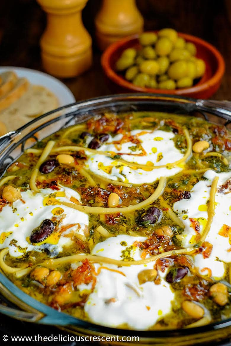 dish of Persian noodle soup topped with yoghurt