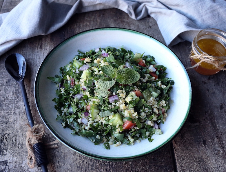 green salad with fresh herbs and rice