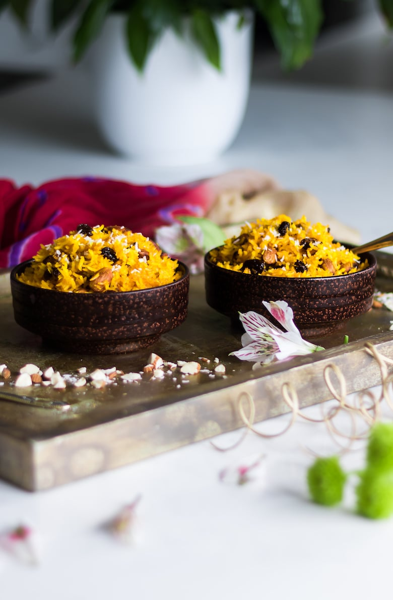 bowls of zarda (sweet rice) on a gold tray