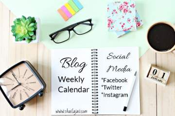 Blog and Social Media Calendar in a weekly planner. Diary with pen, glasses, a clock and a plant placed on a table.