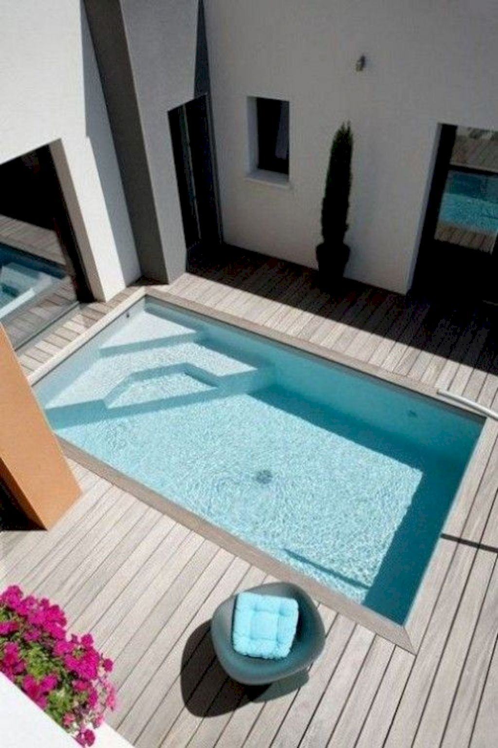 Affordable rectangular pool designs built in small areas that give a lavish look getting along with beautiful landscape (25)