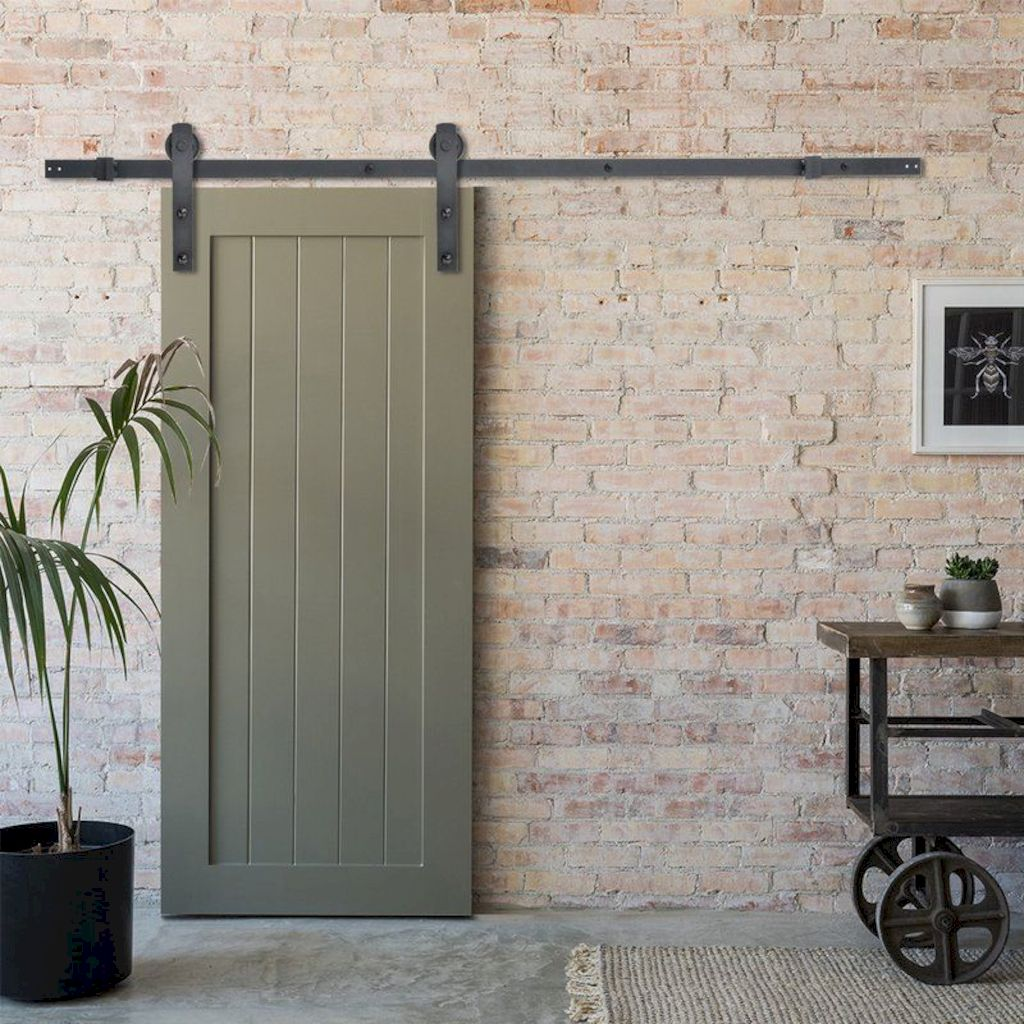 Barn style sliding doors applied as bedroom doors showing a rustic accent in the modern country homes Image 24