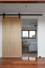 Barn style sliding doors applied as bedroom doors showing a rustic accent in the modern country homes Image 29