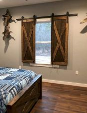 Barn style sliding doors applied as bedroom doors showing a rustic accent in the modern country homes Image 30
