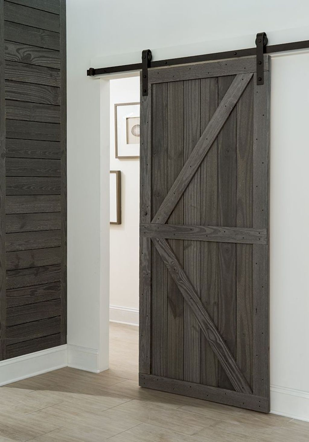 Barn style sliding doors applied as bedroom doors showing a rustic accent in the modern country homes Image 32