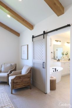 Barn style sliding doors applied as bedroom doors showing a rustic accent in the modern country homes Image 35