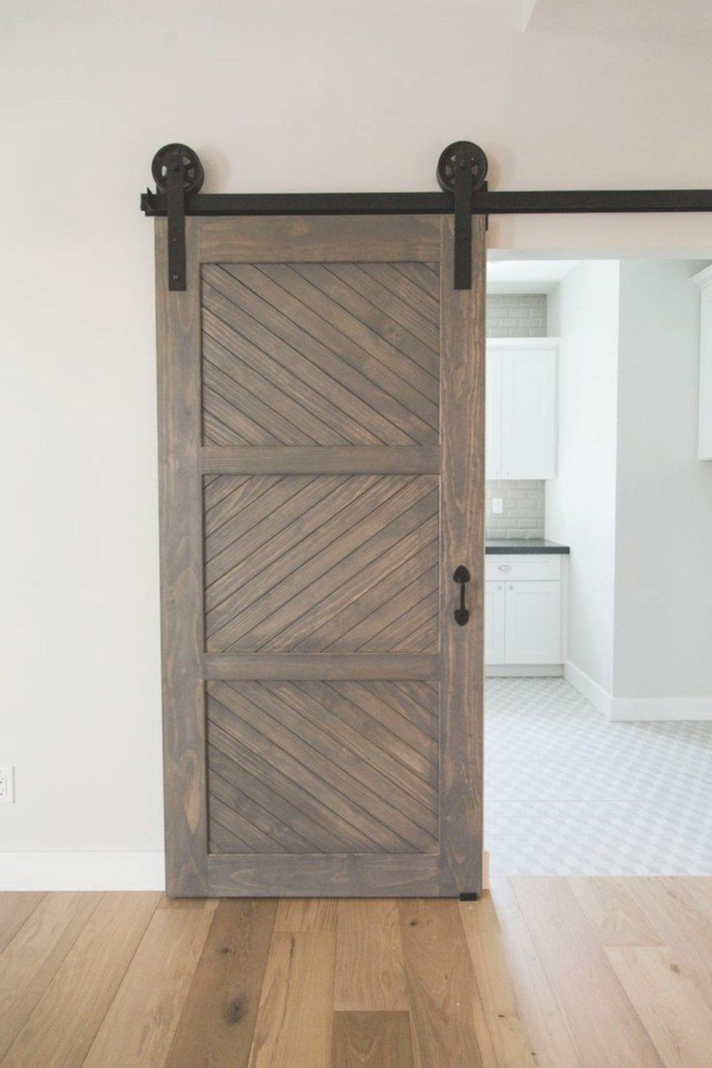Barn style sliding doors applied as bedroom doors showing a rustic accent in the modern country homes Image 38