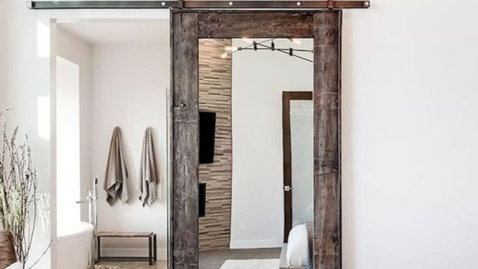 Barn style sliding doors applied as bedroom doors showing a rustic accent in the modern country homes Image 7