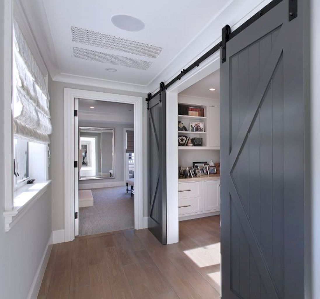 Barn style sliding doors applied as bedroom doors showing a rustic accent in the modern country homes Image 9