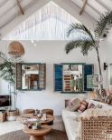 Coastal cottage living area with pure bright schemes outlooking vast sea view giving a complete beach style home Image 1