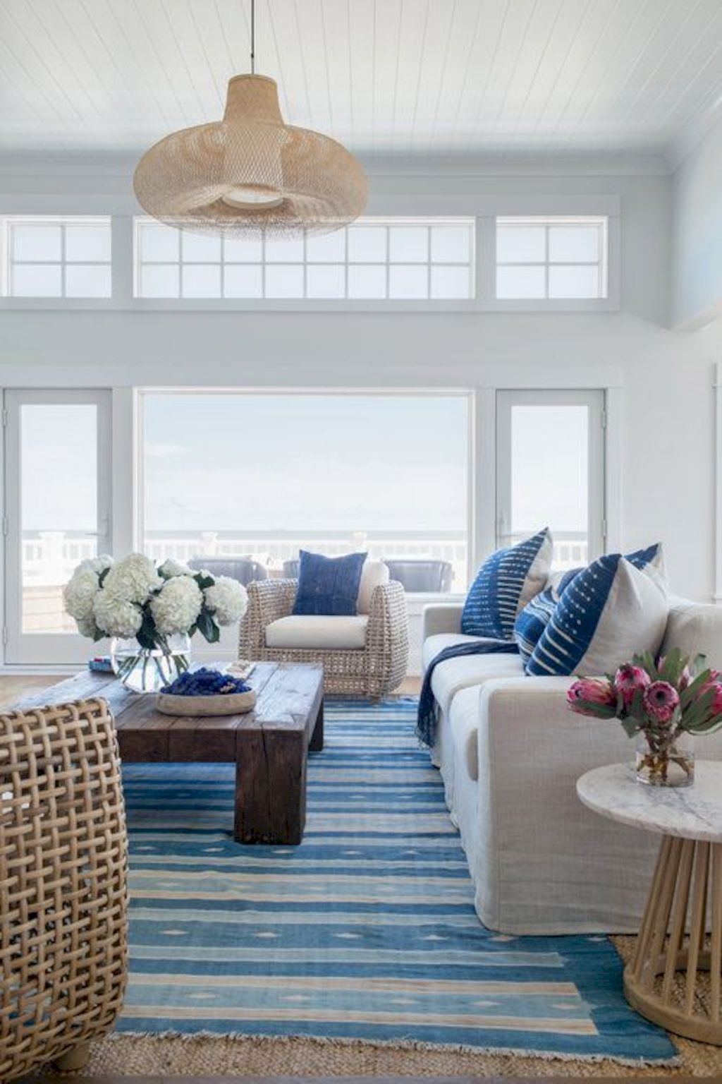 Coastal cottage living area with pure bright schemes outlooking vast sea view giving a complete beach style home Image 16