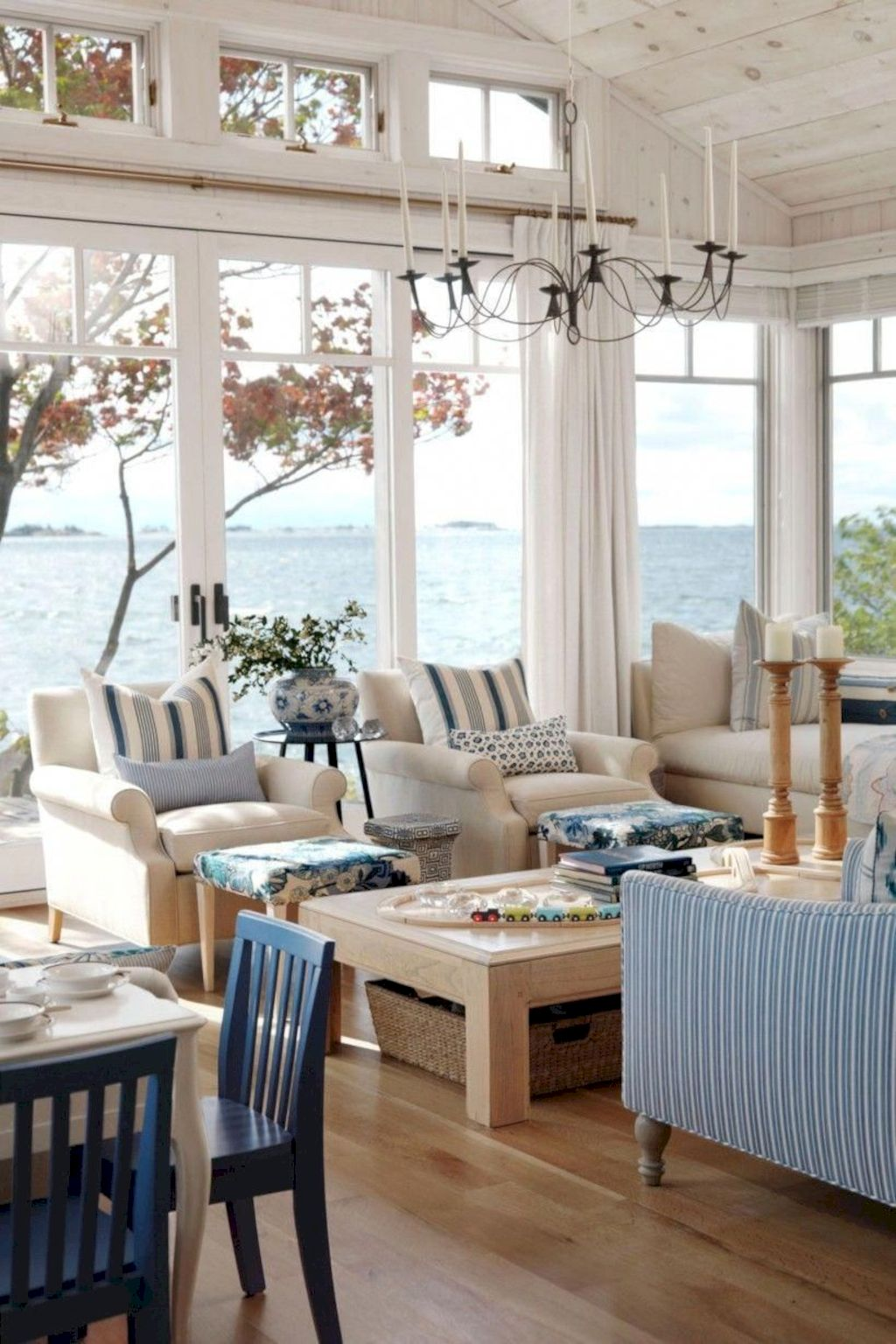 Coastal cottage living area with pure bright schemes outlooking vast sea view giving a complete beach style home Image 17