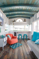 Coastal cottage living area with pure bright schemes outlooking vast sea view giving a complete beach style home Image 2