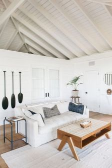 Coastal cottage living area with pure bright schemes outlooking vast sea view giving a complete beach style home Image 22