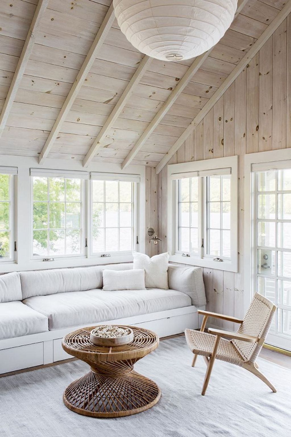 Coastal cottage living area with pure bright schemes outlooking vast sea view giving a complete beach style home Image 26