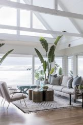 Coastal cottage living area with pure bright schemes outlooking vast sea view giving a complete beach style home Image 6