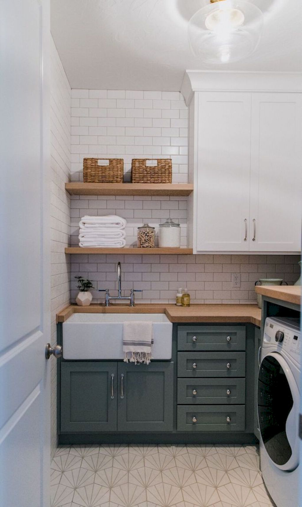 Making a simple laundry room update to maximize its function and look together with cheap accessories and simple layout designs Image 23