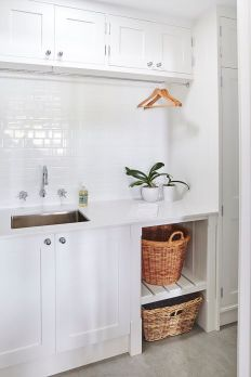 Making a simple laundry room update to maximize its function and look together with cheap accessories and simple layout designs Image 8