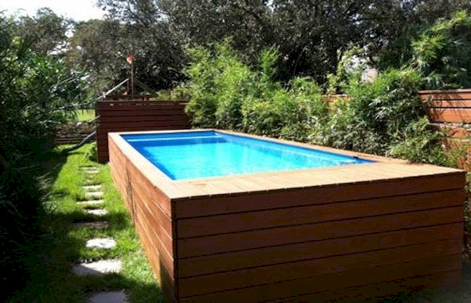 Simple pool designs built above ground designed with cheap materials for simple outdoor relieves Image 2