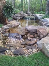 Amazing waterfall ideas giving the best look and panoramic schemes for your landscaping style Image 11
