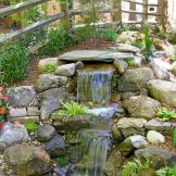 Amazing waterfall ideas giving the best look and panoramic schemes for your landscaping style Image 3