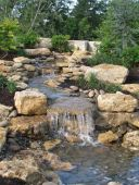 Best small waterfall designs giving the best natural refreshment in such a brilliant backyard with water features Image 25