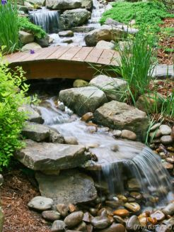 Best small waterfall designs giving the best natural refreshment in such a brilliant backyard with water features Image 31