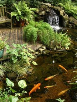 Best small waterfall designs giving the best natural refreshment in such a brilliant backyard with water features Image 32