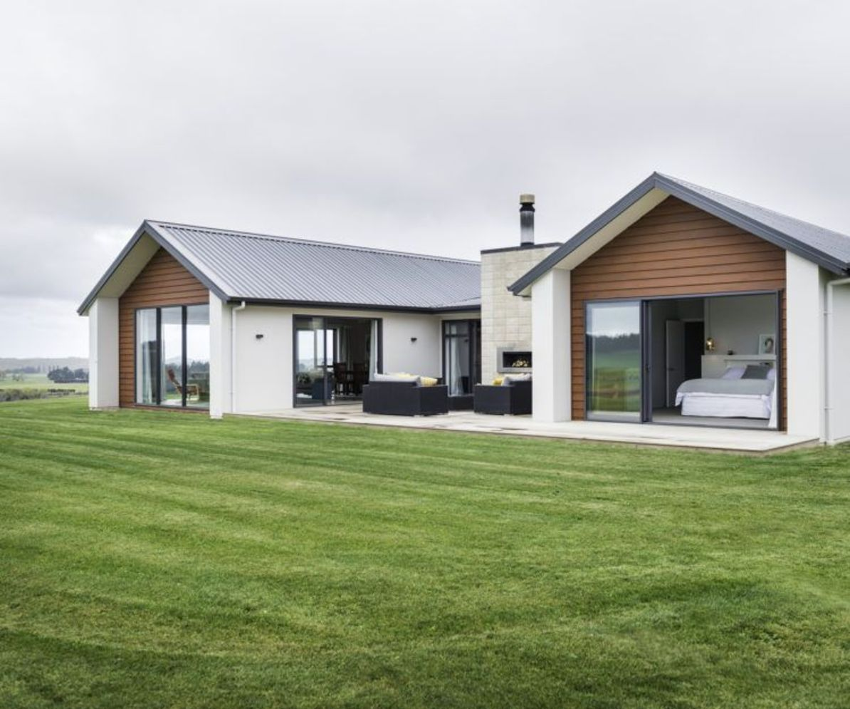 Countryside house with modern Farmhouse exterior design bringing up the traditional style in new classy look Image 16